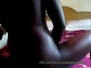 Naughty African lezzie fucks horny big booty sista in homemadebathroom