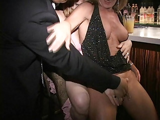 Big nipple masked MILF Carla eats out cunt and sucks hard cock at bar
