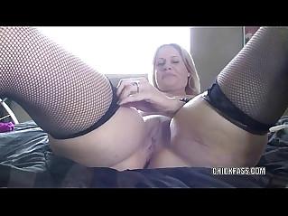 Raunchy MILF fucks her wet twat with a dildo